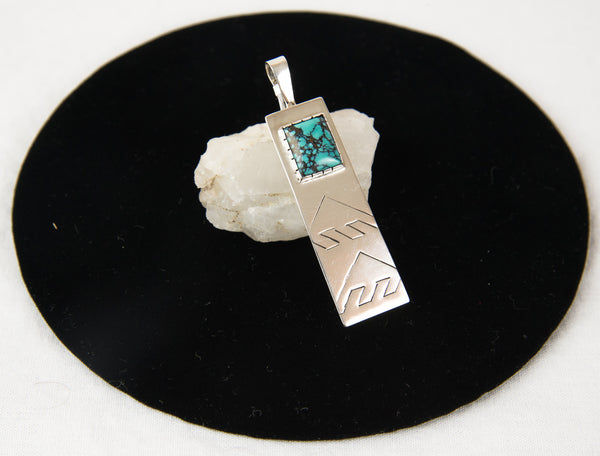 Concave Tibet Turquoise Stamped Two Rain Cloud Motif Pendant by Patrick Smith