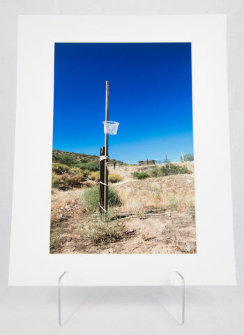 """Grandson's Laundry Basket"" Matted Photograph by Joe Cornett"