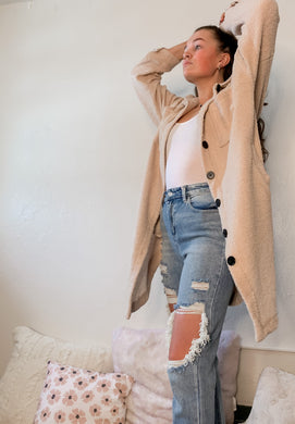 Trendy oversized sweater jacket in cream. Super soft and cozy.