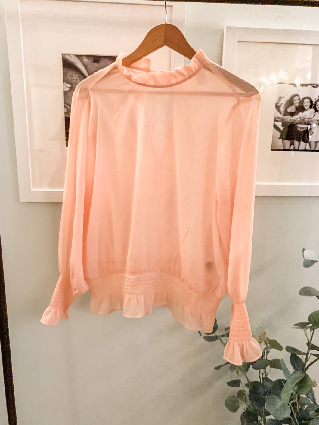 Light pink sheer top.  Pair with a bralette or undershirt! Dress up or great for a beach day!