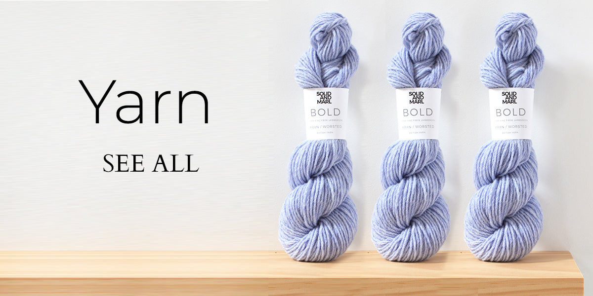 Three skeins of blue aran weight yarn