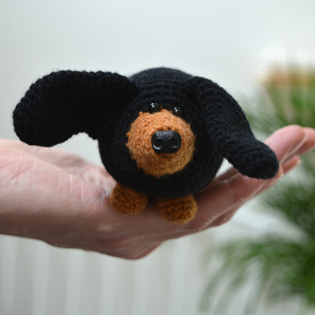 amigurumi sausage dog crochet kit held in hand