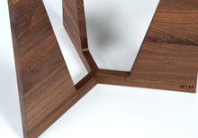 Close-up of leg joint on original custom mid-century modern style side table with triangular top and three triangular legs available in oak or walnut