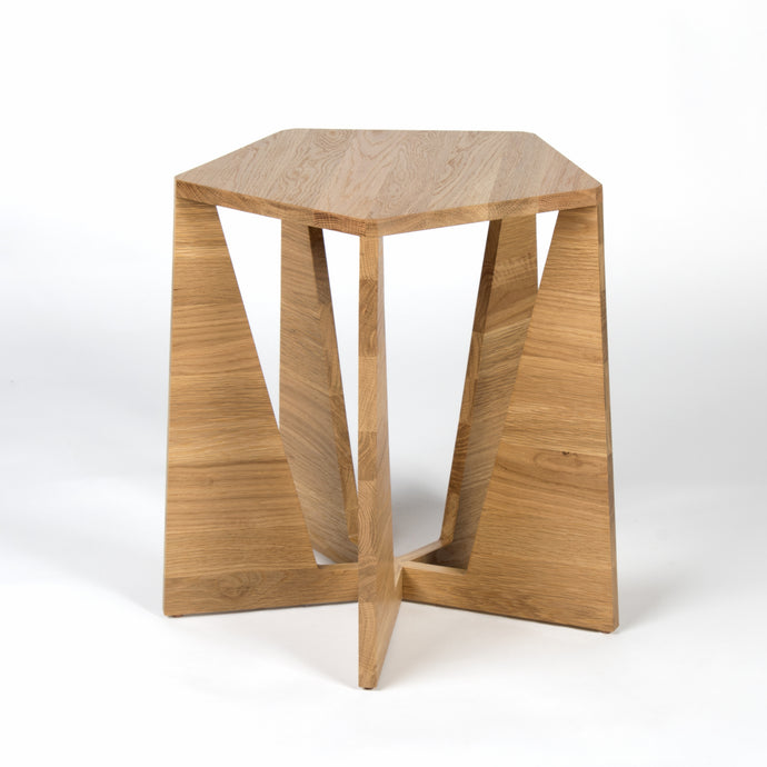 Close-up of leg joint on original custom mid-century modern style side table with pentagonal top and five triangular legs available in oak or walnut