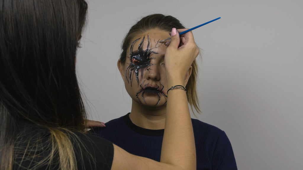 Black paint is used to create cracking details around the eye socket
