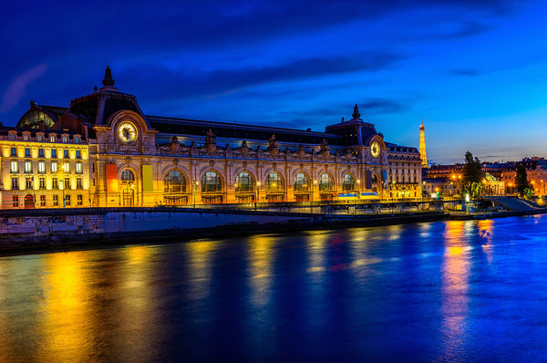 Night shot of the Musée d'Orsay in Paris, France. Credit: Adobe Stock Photo