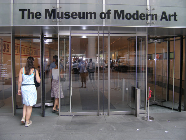 The front door of the MoMA in New York, New York. Credit: Adobe Stock Photo