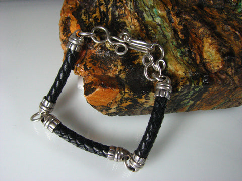 Sterling silver and braided leather unisex bracelet.