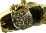 Handmade Solid Bronze 2 sided Pendant with wire wrapped Mother of Pearl Carvings