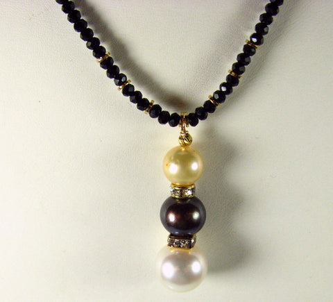Colored Pearl Pendant with White, Black and Gold Pearls.