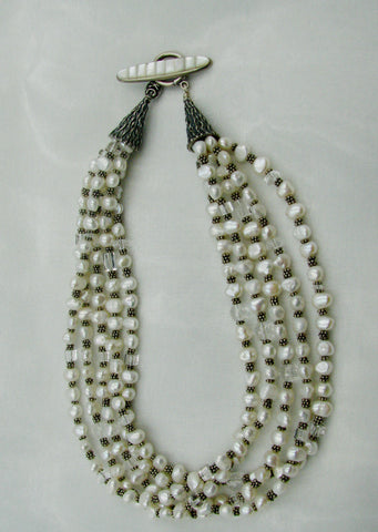Sterling Silver and 5 strand White Pearl necklace.