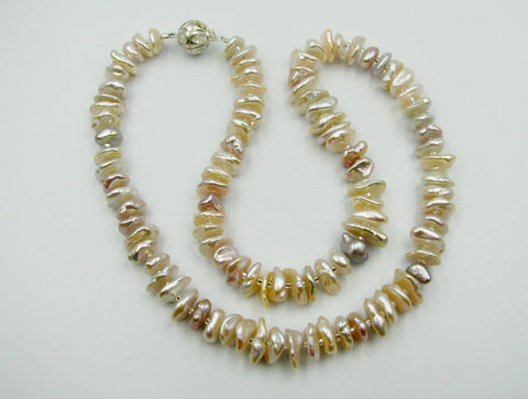 Natural color Eighteen inch Beautiful Keshi Pearl Necklace with sterling silver clasp.