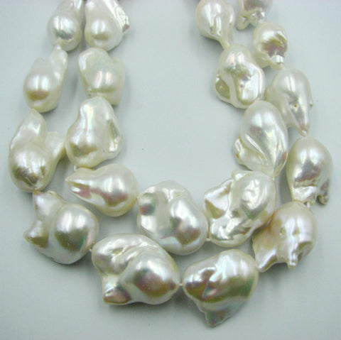 Very large Beautiful White Fresh Water Baroque Pearls.