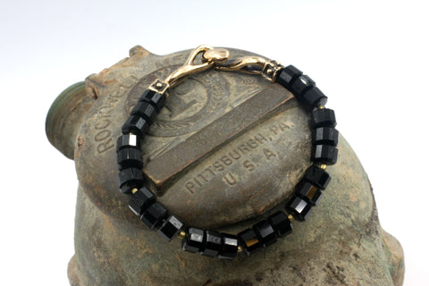Faceted Black Onyx Rondells & Bronze Bracelet.