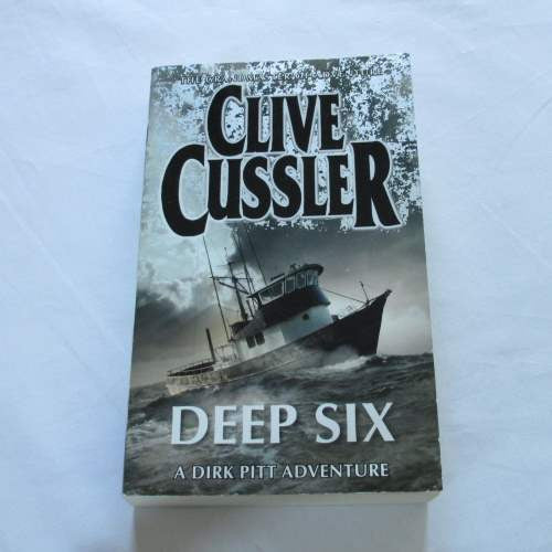 Deep Six by Clive Cussler. A paperback action & adventure novel.