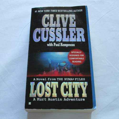Lost City by Clive Cussler. A paperback action & adventure novel.
