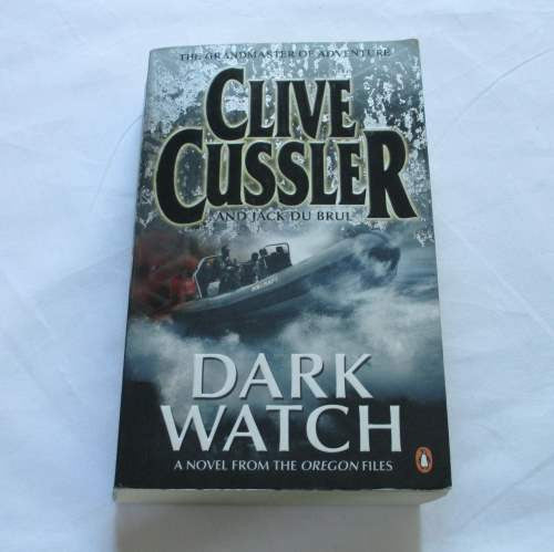 Dark Watch by Clive Cussler. A paperback action & adventure novel.