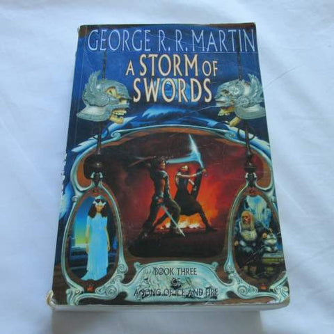 A Storm of Swords by George R. Martin. A paperback Fantasy novel.