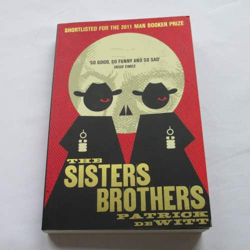 The Sisters Brothers by Patrick deWitt. A paperback contemporary novel.