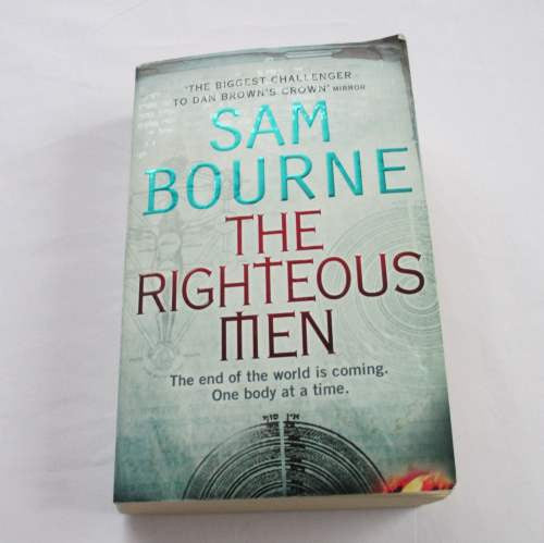 The Righteous Men by Sam Bourne. A paperback action & adventure novel.