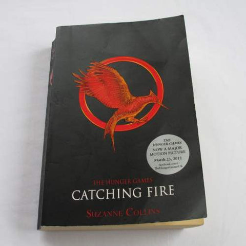 Catching Fire by Suzanne Collins. A paperback Science Fiction novel.