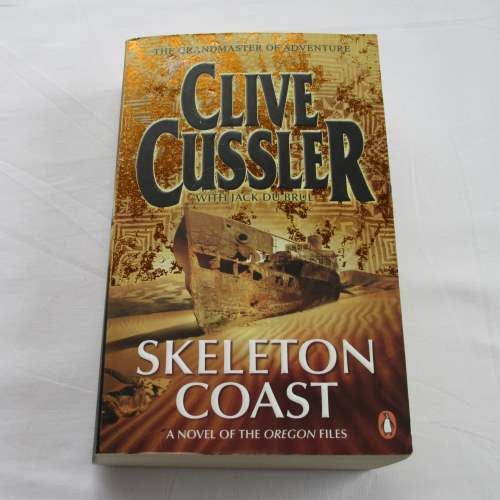 Skeleton Coast by Clive Cussler. A paperback action & adventure novel.