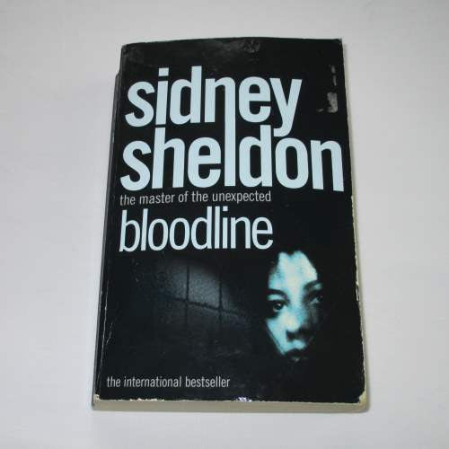 Bloodline by Sidney Sheldon. A paperback action & adventure novel.