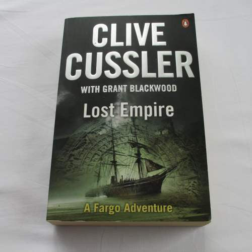 Lost Empire by Clive Cussler. A paperback action & adventure novel.