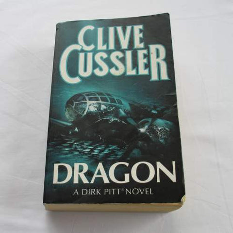 Dragon by Clive Cussler. A paperback action & adventure novel.