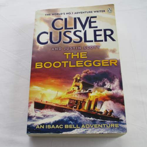 The Bootlegger by Clive Cussler. A paperback action & adventure novel.