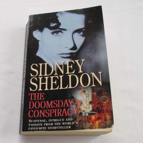 The Doomsday Conspiracy by Sidney Sheldon. A paperback action & adventure novel.