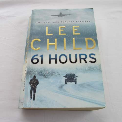 61 Hours by Lee Child. A paperback thriller-mystery novel.