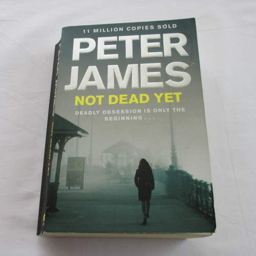 Not Dead Yet by Peter James. A paperback thriller & mystery novel.