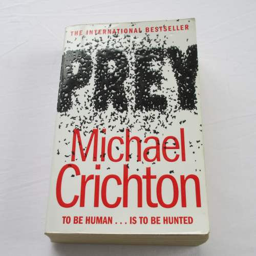 Prey by Michael Crichton. A paperback thriller & mystery novel.