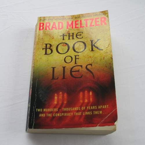 The Book Of Lies by Brad Meltzer. A paperback thriller & mystery novel.