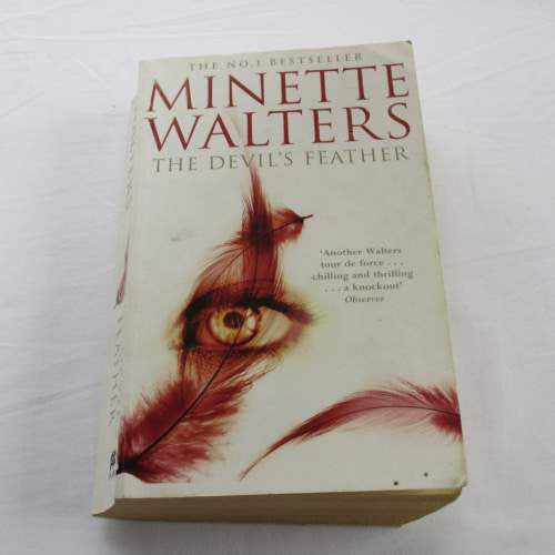 The Devil's Feather by Minette Walters. A paperback thriller & mystery novel.