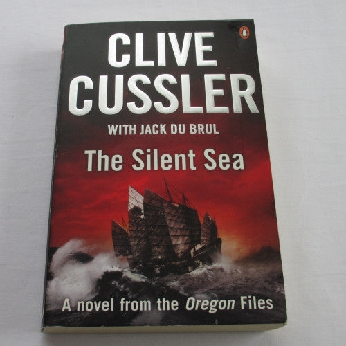 The Silent Sea by Clive Cussler. A paperback action & adventure novel.