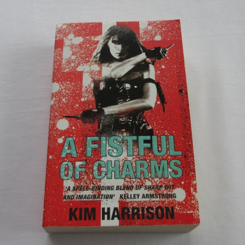 A Fistful Of Charms by Kim Harrison. A paperback Fantasy novel.