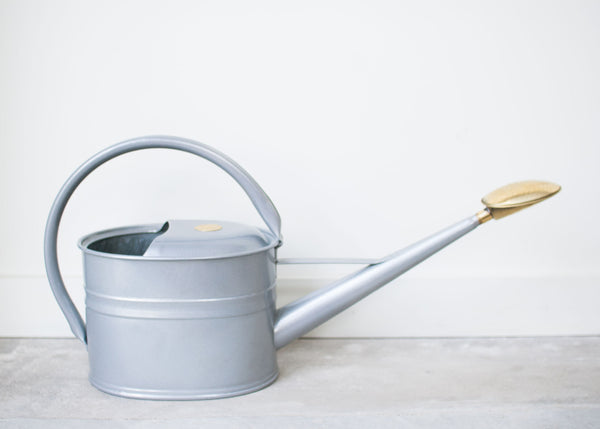 large metal watering can