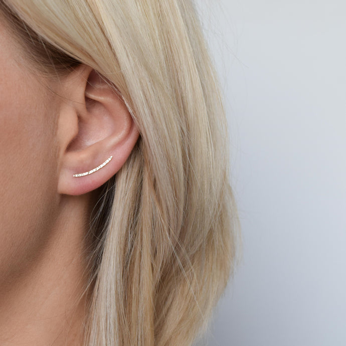 9ct gold hammered ear climbers being worn by blonde haired model