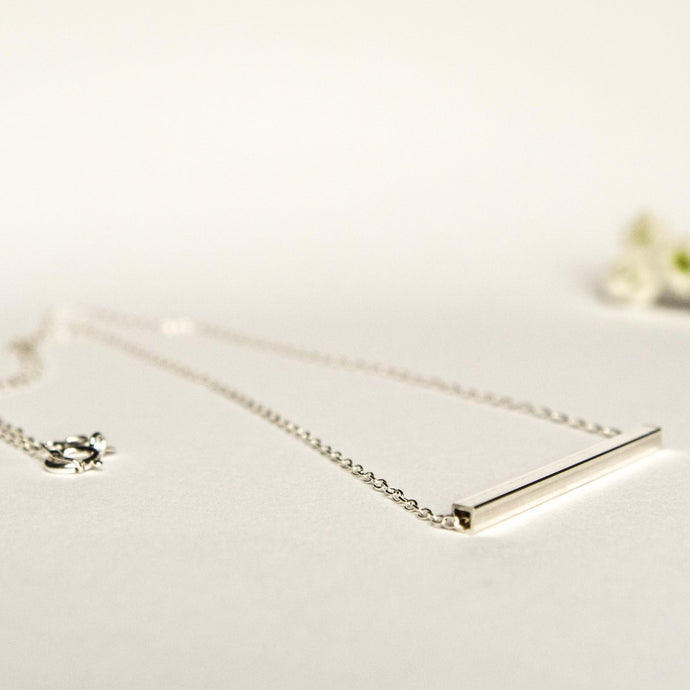 Delicate silver tube necklace with square edged tube pendant