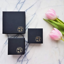MUKA studio jewellery packaging boxes, black box with gold logo in bottom right corner of box
