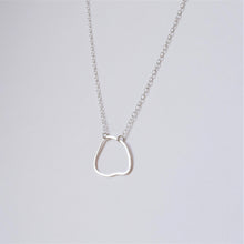 Irregular shaped silver pendant by MUKA studio handmade jewellery