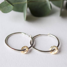 Silver hoop earrings with textured gold charm