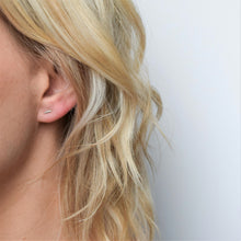 Handmade silver bar stud earrings worn by blond model