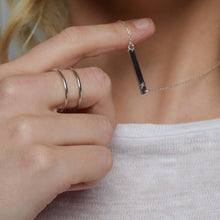silver cage ring on model, worn next to silver bar necklace, personalised with initial K
