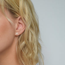 Silver chevron stud earrings on model
