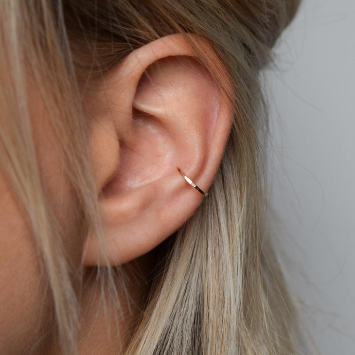 9ct rose gold ear cuff, conch cuff on model