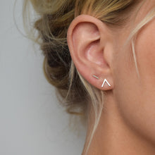 silver handmade chevron stud earrings worn on model alongside silver bar studs