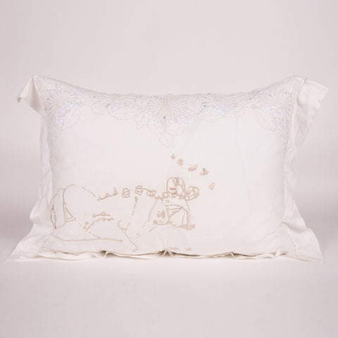 White vintage pillow with pink embroidered artwork by Natalie Krim